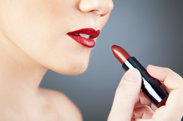 woman-applying-red-lipstick